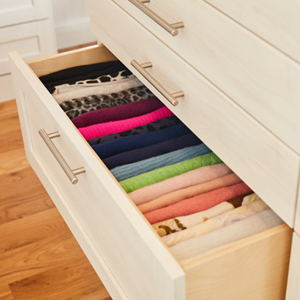 file organized sweaters in drawer